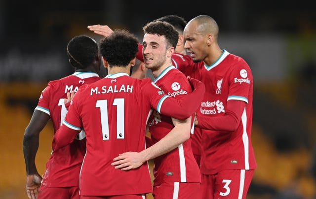 Liverpool's Diogo Jota celebrates with Mohamed Salah and Fabinho after scoring against Wolves