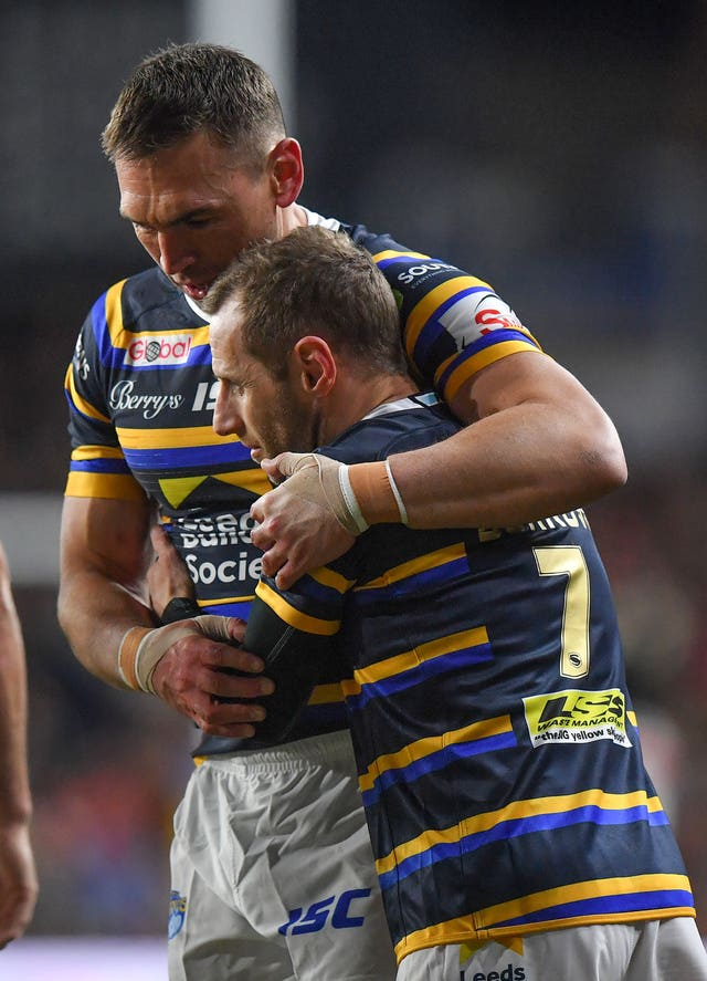 Kevin Sinfield (left) hugs Rob Burrow after his emotional final Leeds performance, during which he played a cameo role following his motor neurone disease diagnosis