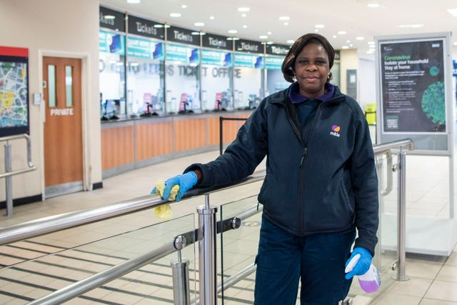 A photo issued by Historic England from its Picturing Lockdown Collection of a Leeds train station cleaner by Samantha Toolsie