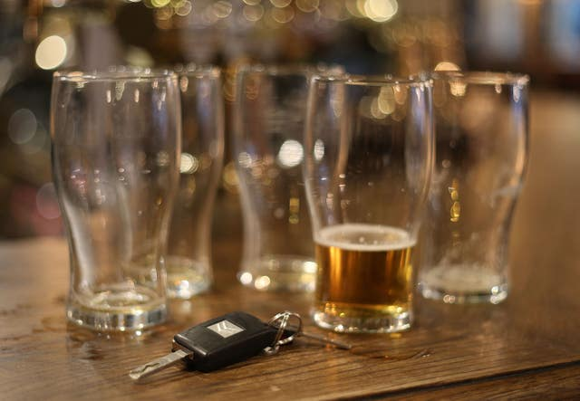 Beer glasses and a set of car keys (Philip Toscano/PA)