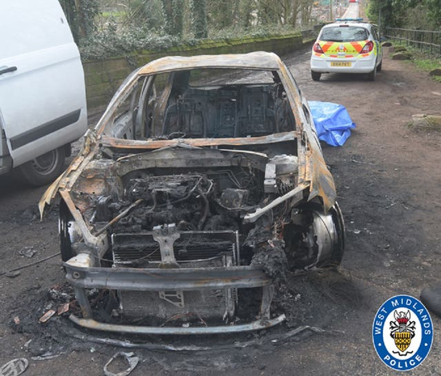 The burnt out remains of the stolen car used in the drive-by murder