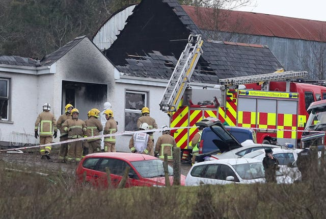 Forensic and fire officers at a house (Brian Lawless/PA)