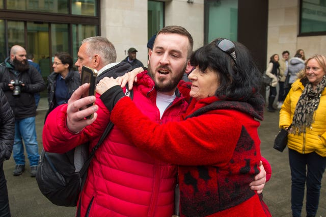 James Goddard is greeted by a supporter as he arrives at Westminster Magistrates' Court