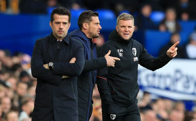 Eddie Howe, right, gestures on the touchline