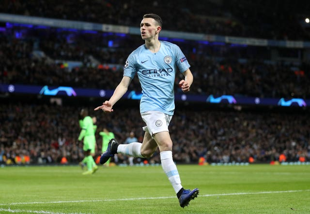 Phil Foden celebrates scoring the sixth goal