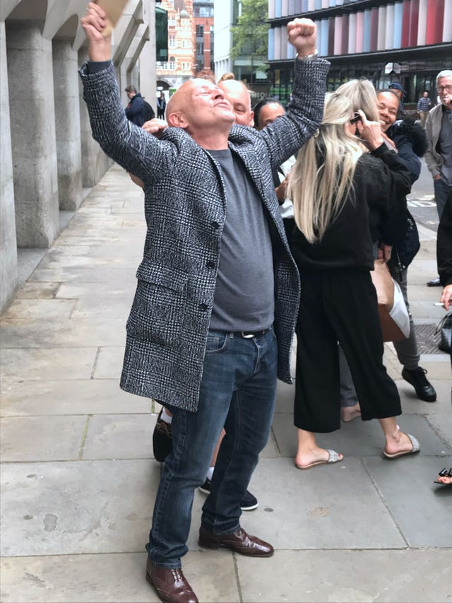 Phillip Huggins celebrates outside the Old Bailey
