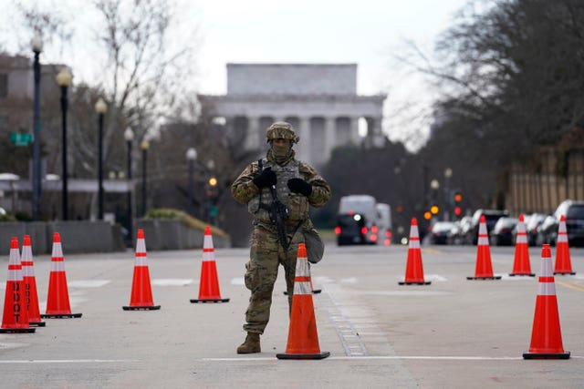 A National Guardsman stands at a road block near the Supreme Court ahead of Joe Biden's inauguration ceremony in Washington