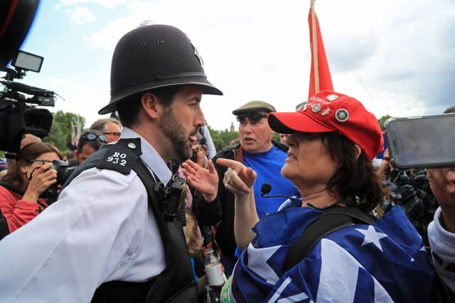 Police kept the peace in London among supporters of the president and protesters during Mr Trump's visit (Gareth Fuller/PA)