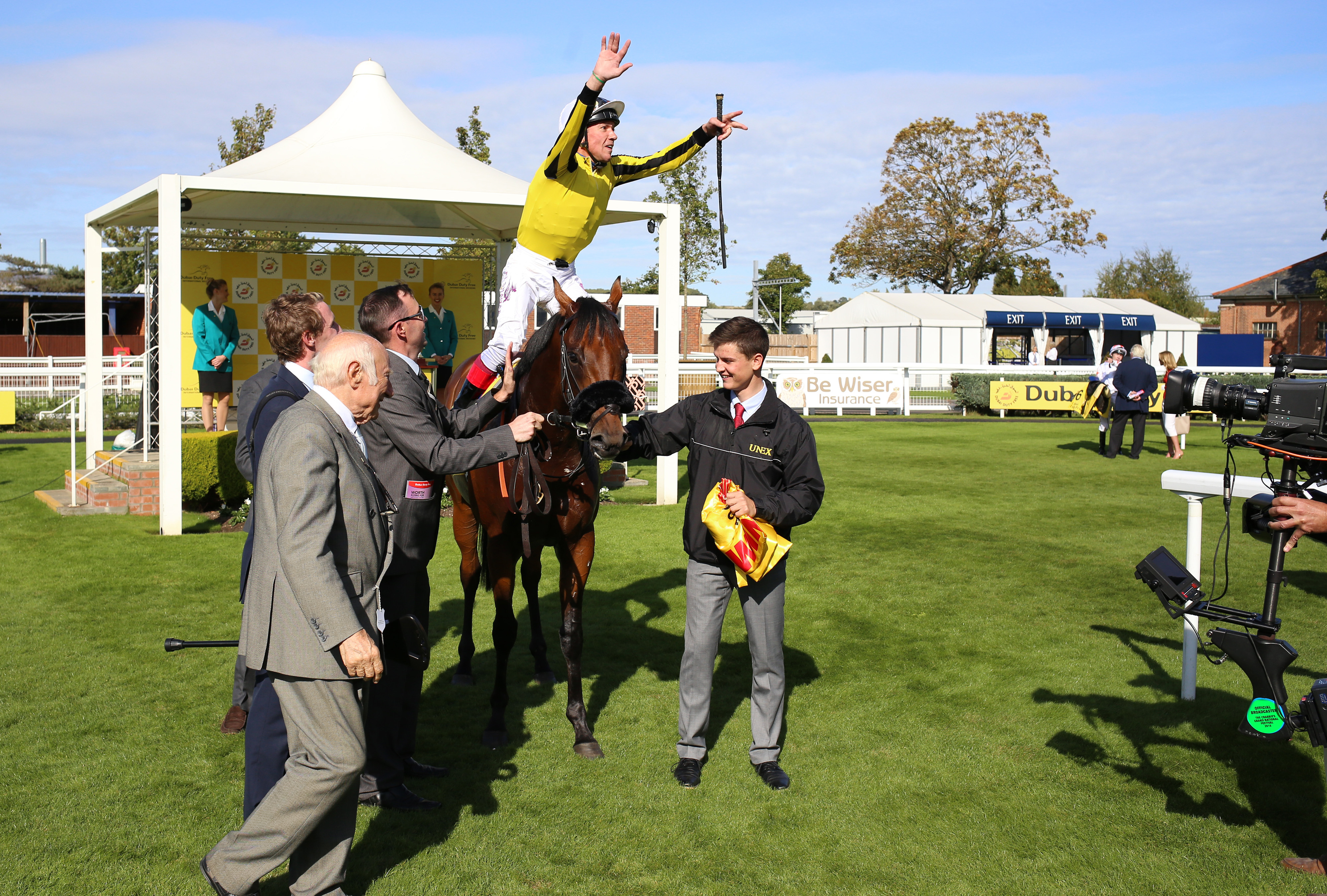 Frankie Dettori leaps from James Garfield after winning last season's Mill Reef Stakes at Newbury