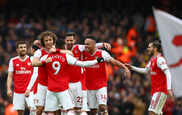 Alexandre Lacazette, centre, celebrates his winner against West Ham with his Arsenal team-mates