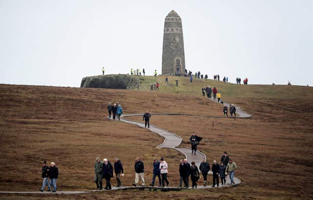 People leave after a service at the American Moment at the Mull of Oa on Islay (PA/Jane Barlow)