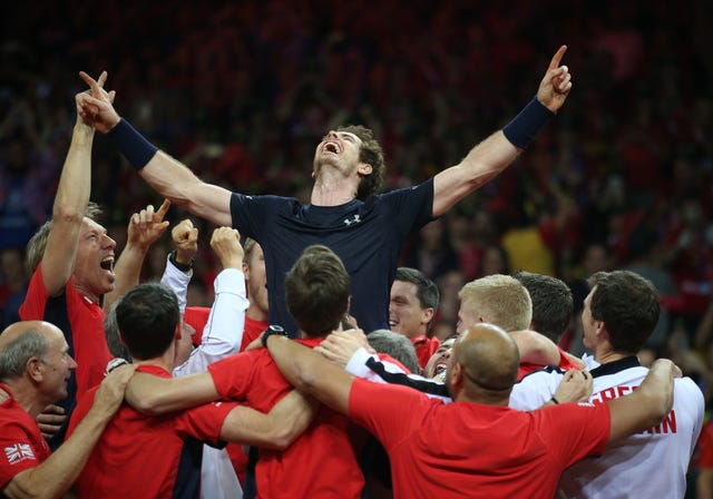 Andy Murray is held aloft by team-mates as they celebrate winning the Davis Cup