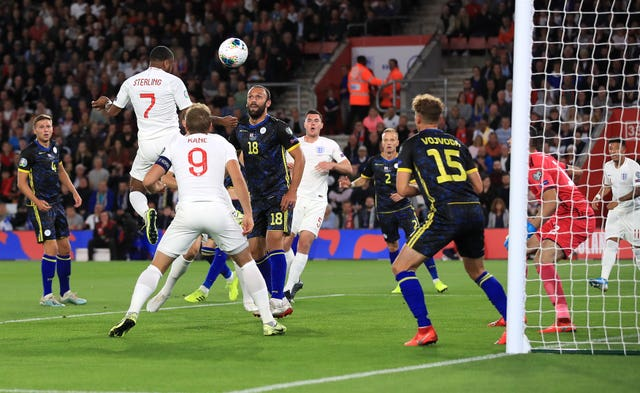 Raheem Sterling, second left, scores in England's 5-3 win over Kosovo
