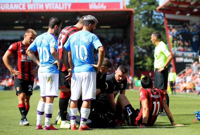 Bournemouth's Charlie Daniels receives medical treatment
