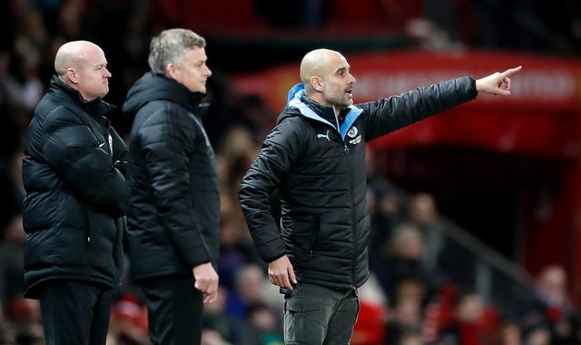 Guardiola, right, shouts instructions during the first leg