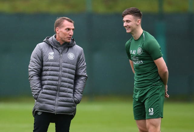Rodgers wants Kieran Tierney (right) and the rest of his defence to tighten up