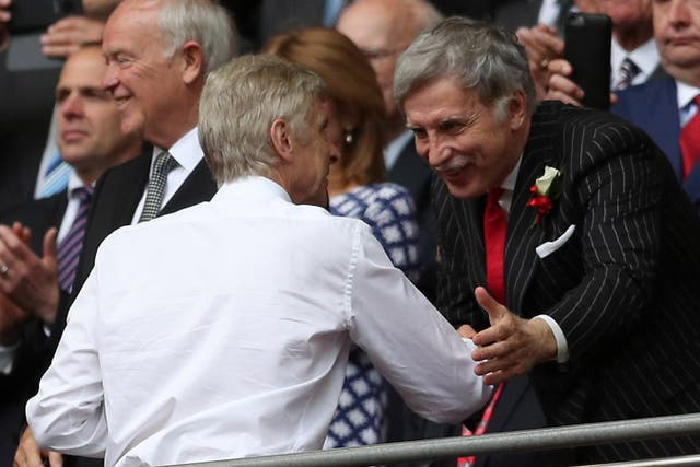 Stan Kroenke (right) is set to take complete control of Arsenal in the coming months.