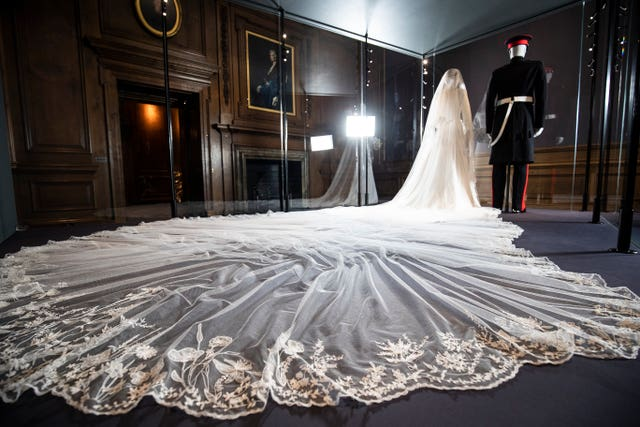 A display of the Duke and Duchess of Sussex's wedding outfits at the Palace of Holyroodhouse, Edinburgh