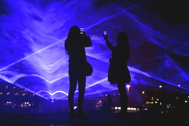 People look at Waterlicht by Daan Roosegaarde at Granary Square (Kirsty O'Connor/PA)