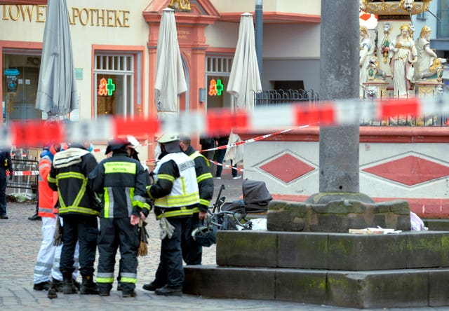 Firefighters at the scene of the incident in Trier (Harald Tittel/AP)