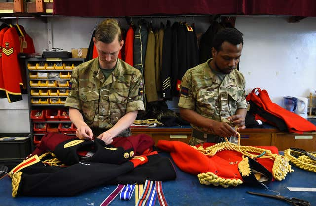 Members of the Household Calvary at work in the Tailors Shop at Hyde Park Barracks, Knightsbridge, London, ahead of the royal wedding (Kirsty O'Connor/PA)
