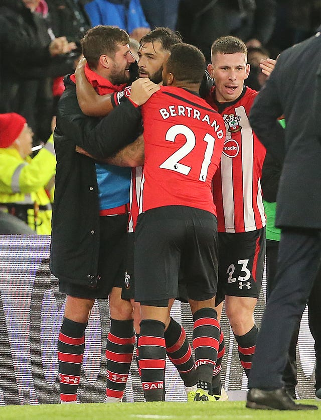 Southampton players celebrate Charlie Austin's goal before it was disallowed