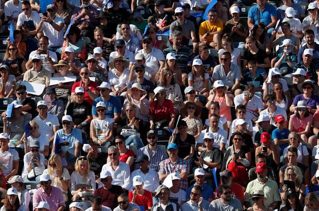 Fans watch a tennis match between Serbia's Novak Djokovic and Germany's Alexander Zverev
