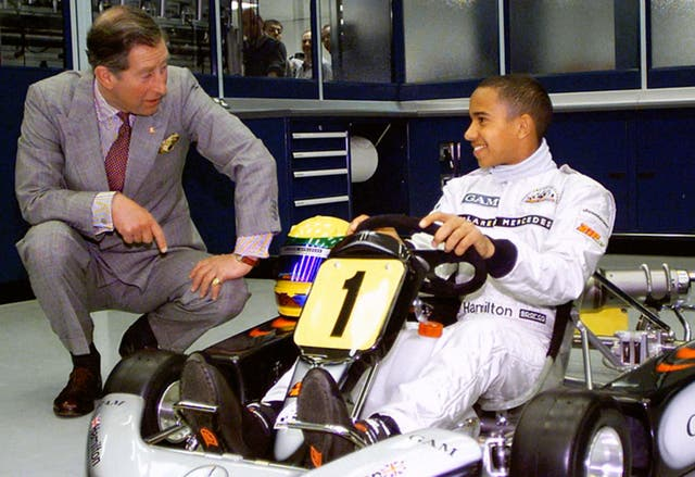 A young Lewis Hamilton with Prince Charles