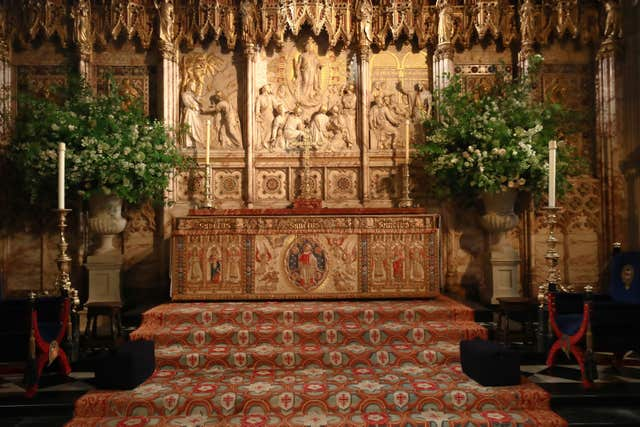 Flowers and foliage at the High Altar of St George's Chapel (Danny Lawson/PA)