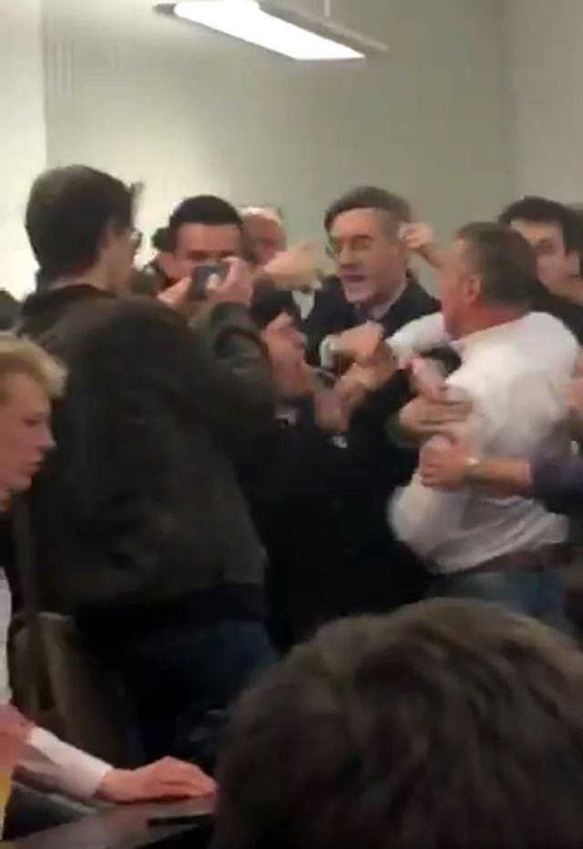 Handout still, taken with permission, from footage posted on the twitter feed of @chloekayex showing Tory MP Jacob Rees-Mogg being caught in the middle of a scuffle at the University of the West England, in Bristol. (@chloekayex)