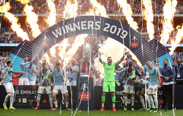 Manchester City skipper Vincent Kompany (centre) lifts the FA Cup after a 60 final victory over Watford