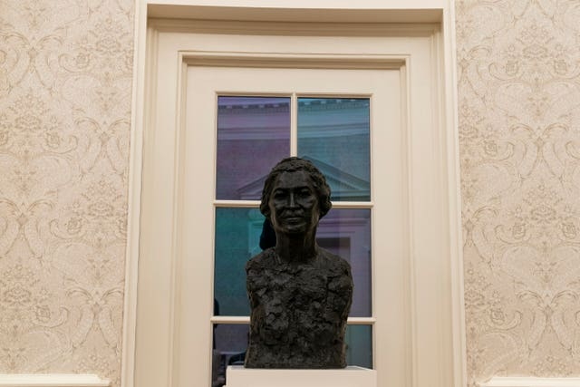 The Oval Office of the White House is newly redecorated for the first day of President Joe Biden's administration, Wednesday in Washington, including a bust of civil rights leader Rosa Parks