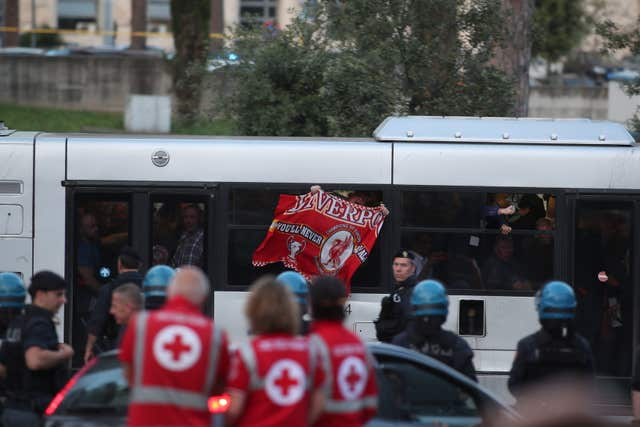 Liverpool fans arrive by shuttle bus (Steve Parsons/PA)