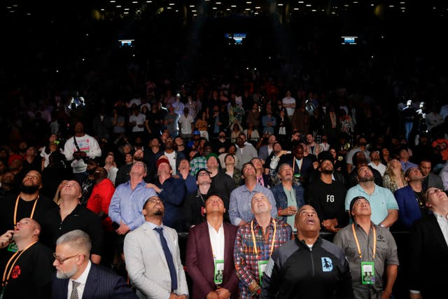 Fans watch a replay of Deontay Wilder knocking out Dominic Breazeale