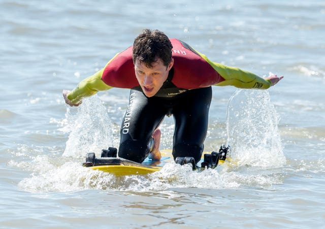 An RNLI Lifeguard takes to the water in Bridlington, East Yorkshire