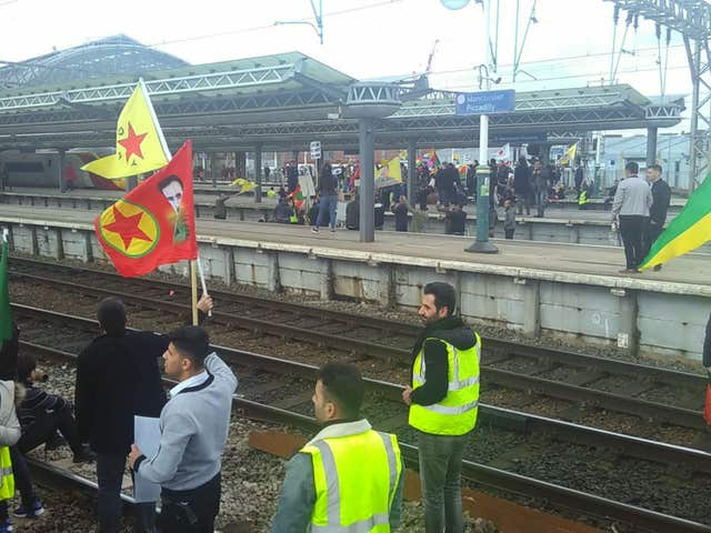 Protesters against Turkish war on Syrian Kurds block the tracks at Manchester Piccadilly station bringing rail services in and out of the terminal to a halt. (PA Wire / Sophy Colbert)