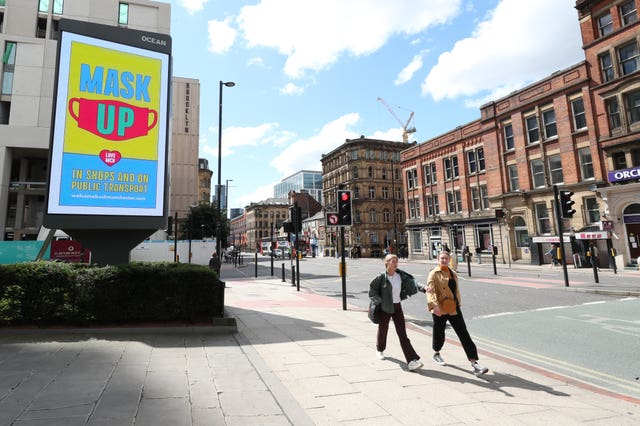 A billboard in Manchester promoting the guidelines on wearing masks (Peter Byrne/PA)