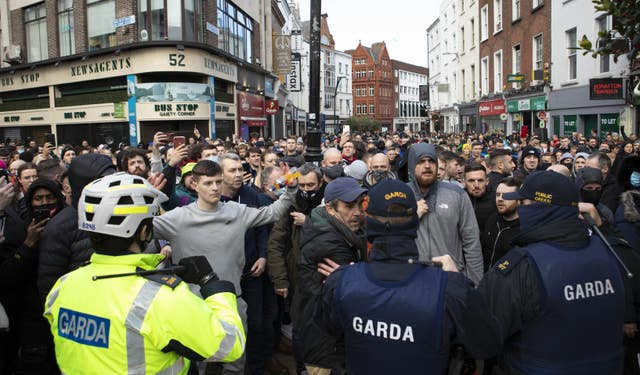 Gardai talk to protesters during an anti-lockdown protest in Dublin city centre