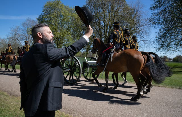 A person salutes the King's Troop Royal Horse Artillery