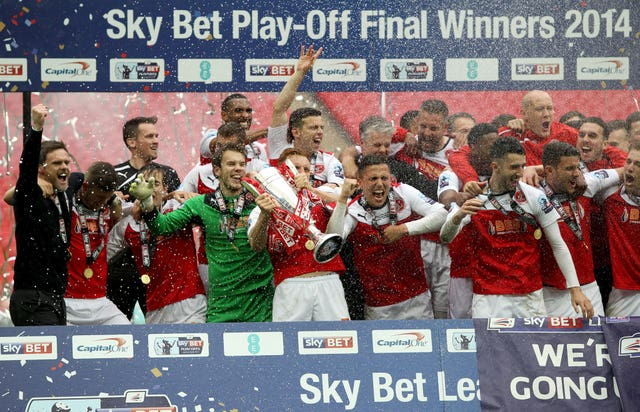Fleetwood celebrate after winning the 2014 League Two play-off final