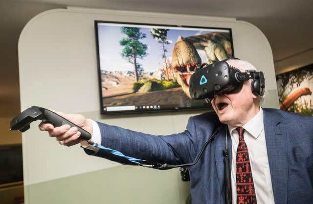 Sir David Attenborough tries out a virtual reality headset (Danny Lawson/PA)