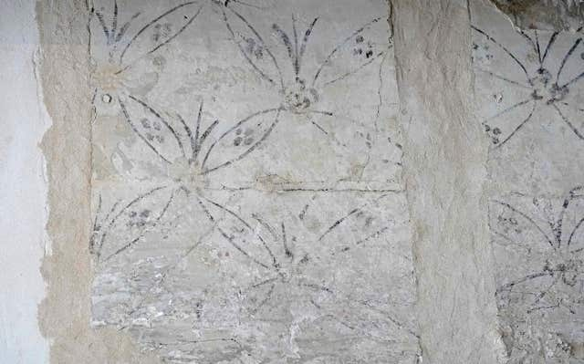 Detail of wall paintings dating back hundreds of years have been found during the work (Owen Humphreys/PA)