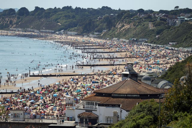 People crowd on the beach in Bournemouth, Dorset, in June