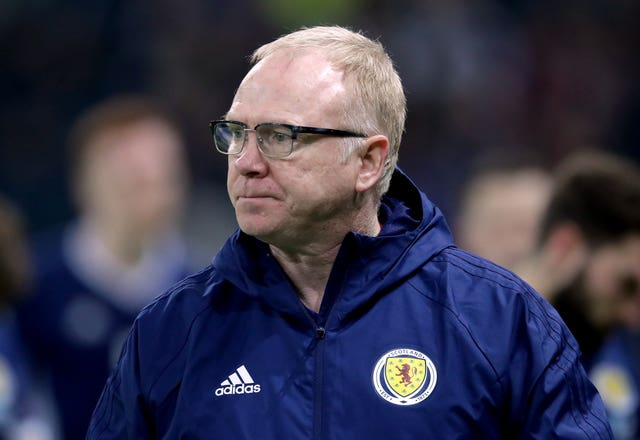 Alex McLeish watches on as his side fall to a heavy defeat