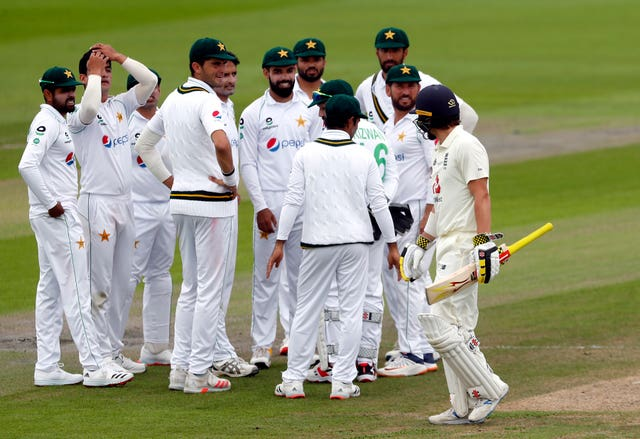 Rory Burns makes his way off the pitch after being dismissed by Pakistan's Mohammad Abbas