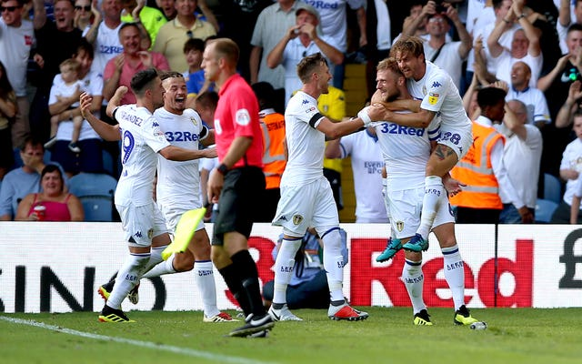 Liam Cooper, second right, celebrates scoring for Leeds in last season's opening win against Stoke