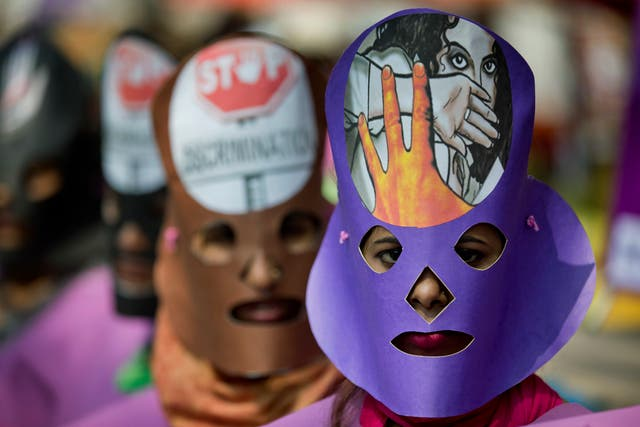 Masked Bangladeshi women attend an International Women's Day rally in Dhaka (A.M. Ahad/AP)