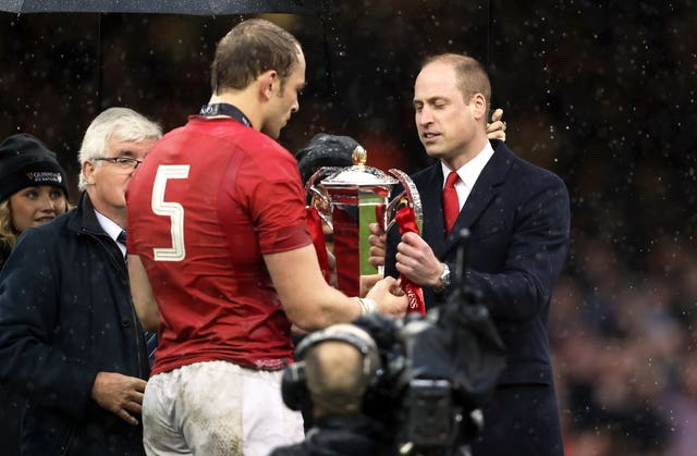 Wales' Alun Wyn Jones is presented with the trophy