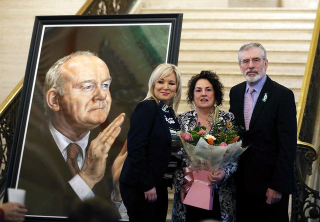 Sinn fein deputy leader Michelle O'Neill (left) and former Sinn Fein leader Gerry Adams with Bernadette McGuinness wife of ex-deputy first minister Martin McGuinness at the unveiling of his portrait (Brian Lawless/PA)