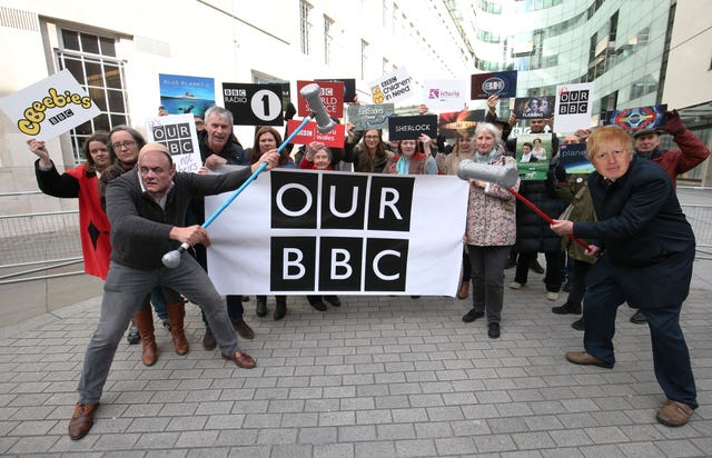 Activists impersonating Dominic Cummings and Boris Johnson take part in a 'whack a mole' photo call outside BBC New Broadcasting House to defend the broadcaster